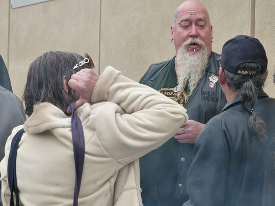 """Donald """"Blue"""" Mobley speaks with a couple of his supporters  last month outside the Shasta County justice center.."""