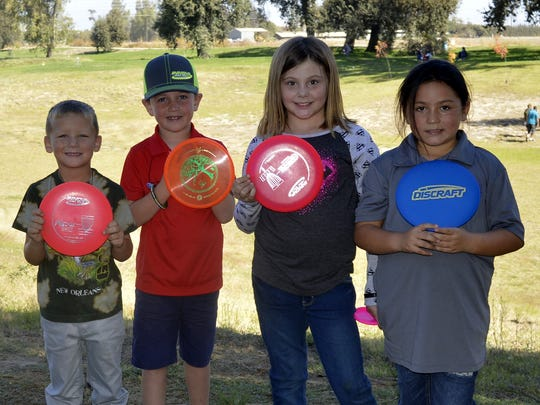 A few of the Junior Disc golfers who competed in the tournament Saturday morning.