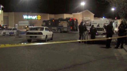 In this photo provided by WDAZ-WDAY TV Grand Forks-Fargo, police investigate the scene of a shooting at a Wal-Mart Supercenter store Tuesday, May 26, 2015, in Grand Forks, N.D. Grand Forks Police said the deadly shooting occurred a few minutes after 1 a.m.