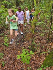 Groups of kids from the YMCA in Bonita Springs walked to Bonita Nature Place on Kent Road. The Friends of the Bonita Nature Place volunteer group runs the tour that features gopher tortoise burrows, a butterfly garden, bee house, bat house and an indoor learning area.