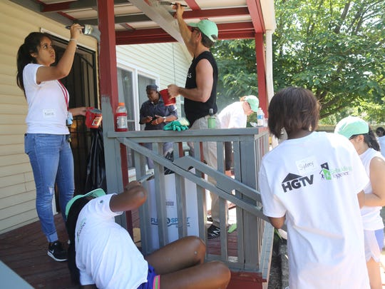 "Volunteers from Thistle Farms, HGTV and more painted the deck of a Thistle Farms home to kick off the ""She Builds"" campaign with HGTV, Rebuilding Together and Thistle Farms on Tuesday."