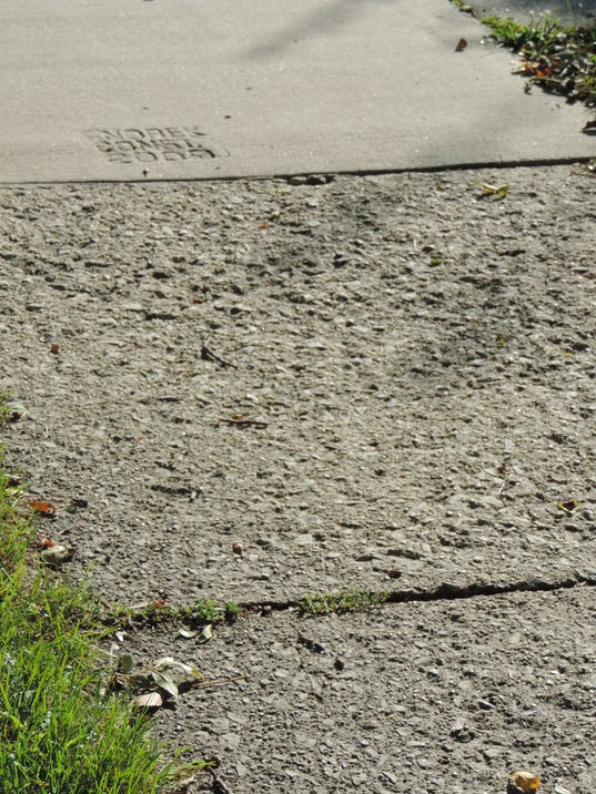 636130280865780829-green-aleys-2c-pocked-sidewalks-and-pesticide-signs-013.JPG