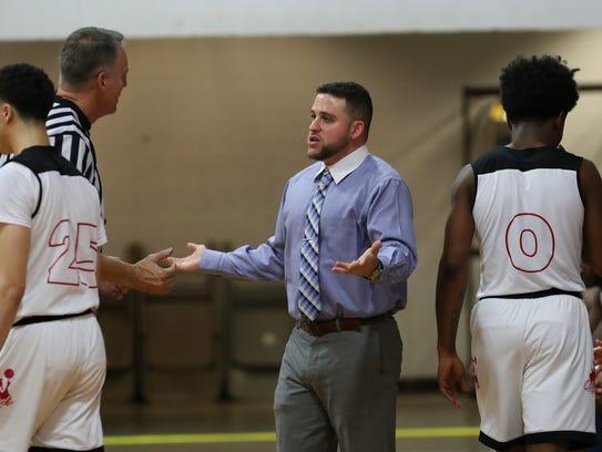 Aspire Academy head coach Jeremy Kipness, center, argued