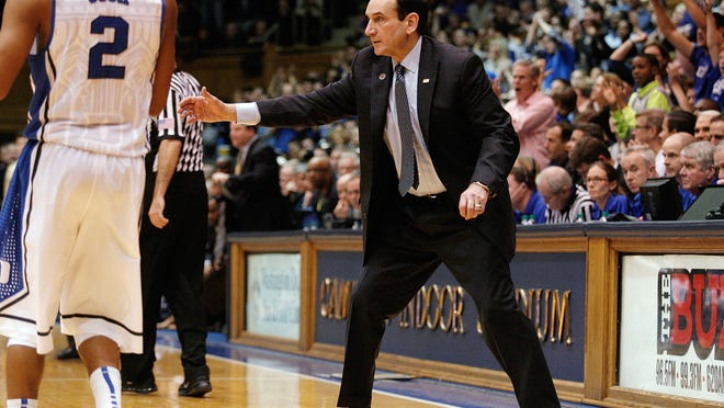 Jan 19, 2015; Durham, NC, USA; Duke Blue Devils head coach Mike Krzyzewski encourages his team against the Pittsburgh Panthers in their game at Cameron Indoor Stadium. Mandatory Credit: Mark Dolejs-USA TODAY Sports