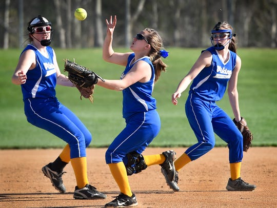 Three Northern Lebanon infielders chase a bouncing