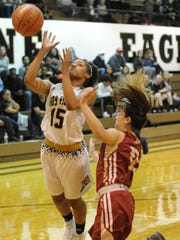 Abilene High's Triniti Wilson (15) drives for a shot while Keller Central's Kalli Oliver defends. The Lady Eagles beat Central 63-49 in the District 3-6A game Tuesday, Jan. 3, 2017 at Eagle Gym.