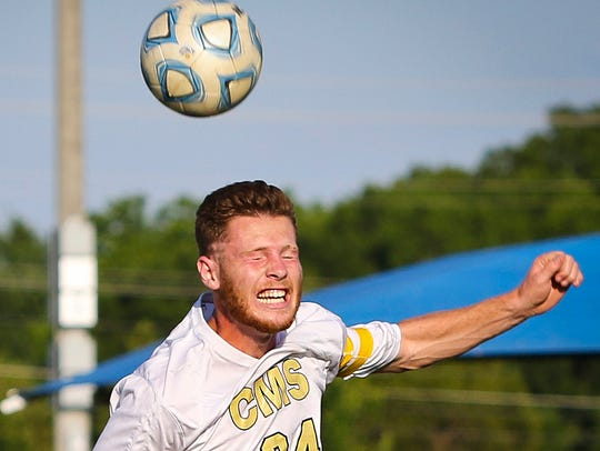 Central Magnet's Kyle Shoemaker heads the ball in the