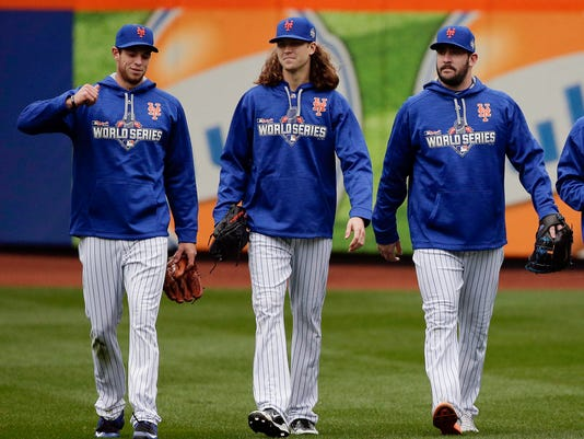 FILE - In this Oct. 24, 2015, file photo, New York Mets pitchers, from left, Steven Matz, Jacob deGrom and Matt Harvey walk off the field at the end of batting practice in New York. New York rode Jacob deGrom, Noah Syndergaard, Matt Harvey and closer Jeurys Familia to the 2015 World Series, then followed that up with a 2016 playoff berth despite a string of significant injuries. Both years, the Mets ranked among the top four teams in ERA. But everything unraveled last season. (AP Photo/Julie Jacobson, File)