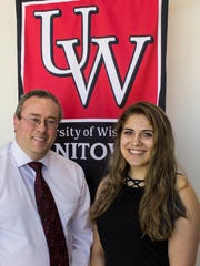 Martin Rudd (left), UW Colleges regional executive officer and dean, congratulates UW-Manitowoc student Bethanie Ebben on receiving the Lee Grugel Memorial Scholarship for her academic achievement and outstanding contributions to campus.