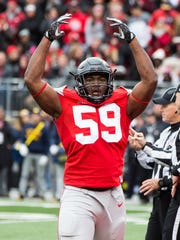 Ohio State defensive end Tyquan Lewis revs up the Ohio Stadium crowd during last year's game with Michigan.