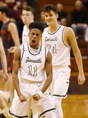 Zionsville's Isaiah Thompson lets out a scream after draining his sixth three-point shot in a row against Harrison in the sectional semifinal March 2, 2018, in Lafayette.
