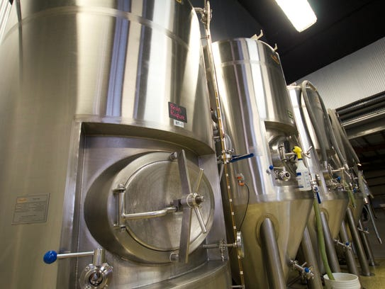 Three fermentation vessels, right, sit next to a conditioning