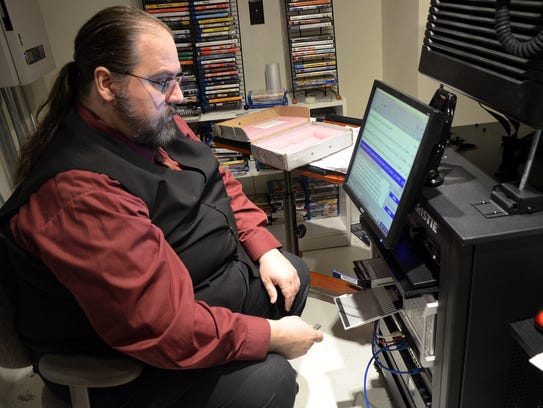 Bob Veramay, the Bohm Theatre's general manager, sets