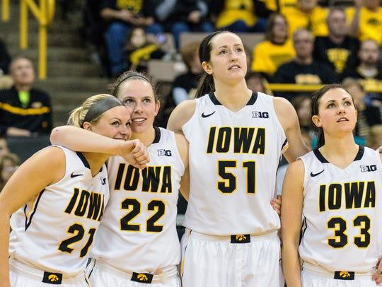 Iowa seniors Melissa Dixon (21), Samantha Logic (22),