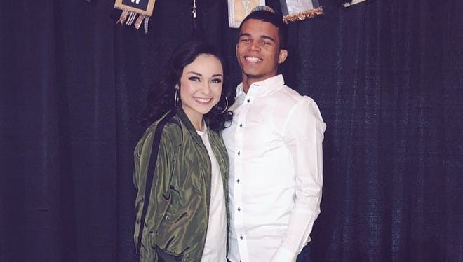Marcus Edwards poses for a photo with his girlfriend, Gabby Pulido.