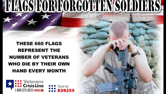 Banners such as this one, which features a picture of Staff Sgt. Joshua Berry, is part of the display in the Flags for Forgotten Soldiers initiative to build awareness of PTSD and the suicide rate among members of the military.