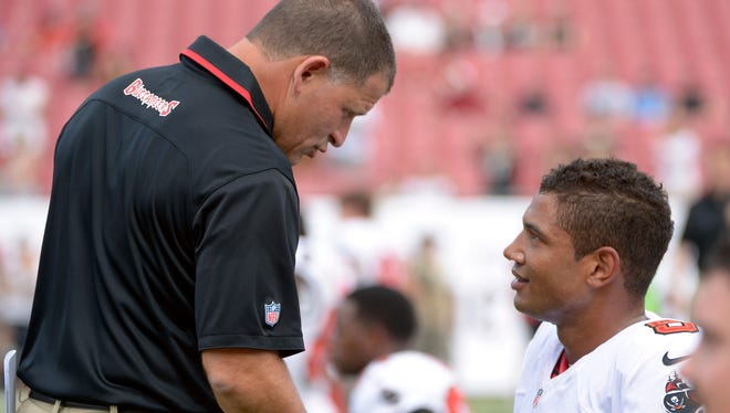 The days of Bucs coach Greg Schiano, left, and QB Josh Freeman shaking hands seem to be over.