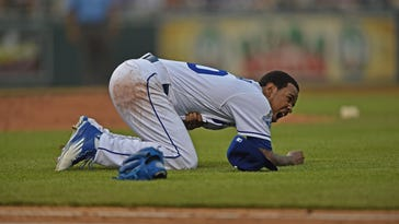 Royals pitcher Yordano Ventura (30) reacts after getting hit with a line drive against the Texas Rangers during the fifth inning at Kauffman Stadium.