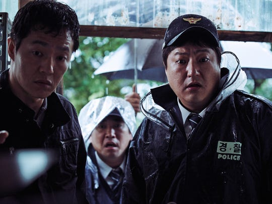 "Kwak Do-Won (right) is a Korean cop dad who worries about how a mysterious infection might affect his family in ""The Wailing."""