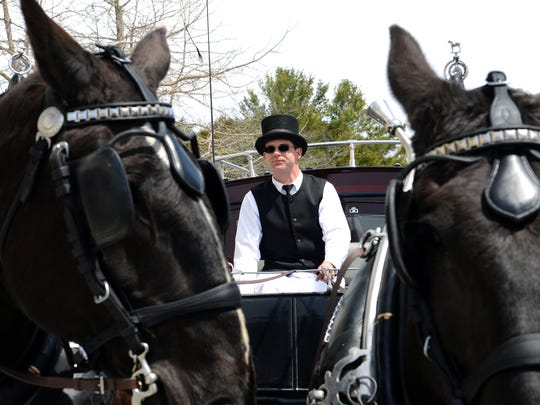 Teamster Blake Shields waits with his horses, Zelda and Mario, outside the Grand Hotel on Mackinac Island Tuesday, May 3, 2016.