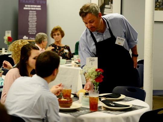 "Ryan Porter serves guest at the 2nd annual ""Empty Bowls"""