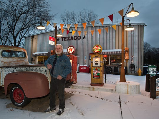 """Bob Norris stands next to some of his """"petroliana"""" collection Friday, December 15, 2017 at Grade A Welding, just north of Fond du Lac."""
