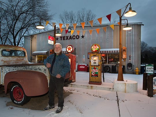 Bob Norris stands next to some of his petroliana collection Friday, December 15, 2017 at the welding business he ran between Fond du Lac and North Fond du Lac since 1974.