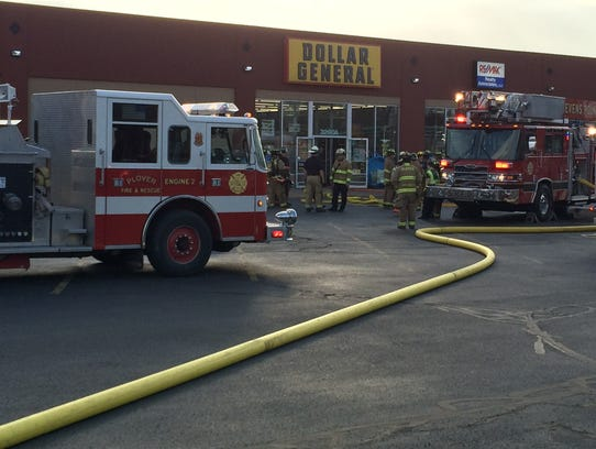 Firefighters respond to a fire at Dollar General on