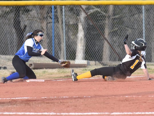 Cotter's Macie Clawson tags Salem's Allyson Walsh on Thursday night at Lady Warrior Field.