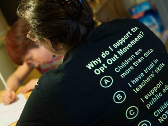 Jackie Kook's T-shirt offers several reasons for opting out of the new standardized tests.