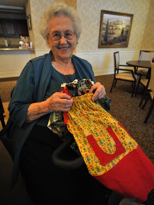 Resident Lois Ramaker, 91, shows some dresses she has made at Birchwood Highlands in Weston.