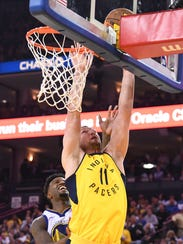 Pacers center Domantas Sabonis (11) shoots the basketball