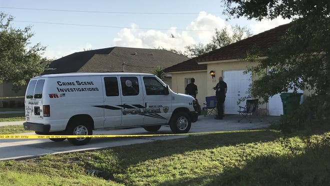 Port St. Lucie police investigate the scene of a home invasion Thursday, May 4, 2017, in the 300 block of Northwest Bayshore Boulevard in Port St. Lucie.