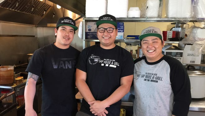 Owner Alain, right, and staff at Ma Der Ma Der in downtown Redding.