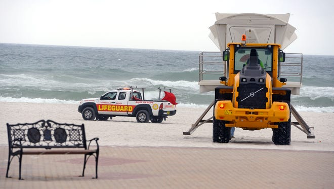 Lifeguard stations are moved from Pensacola Beach Saturday, October 7, 2017 ahead of Hurricane Nate.