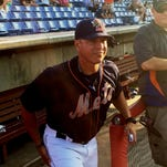 Binghamton Mets manager Pedro Lopez steps out of the dugout at NYSEG Stadium during his Binghamton Baseball Shrine induction ceremony on September 6, 2015.