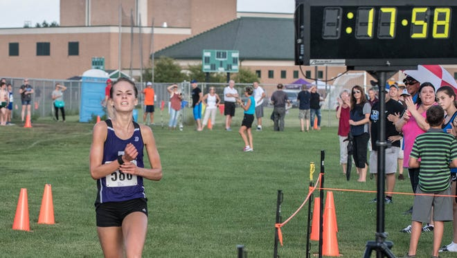 Lakeview senior Maggie Farrell takes first place at the All-City Cross Country Meet at Pennfield High School on Sept. 7. 2016.