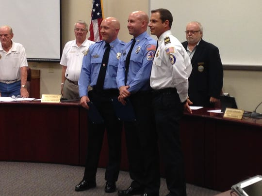 Bonita Springs Firefighter Paramedics Jonathan Whitlock and Brian Hornberger received the Phoenix Award from Chief Joe Daigle. They helped save an 81-year-old man who went into cardiac arrest at his home in June. Acting Lt. Jesse Cottrell was also recognized.