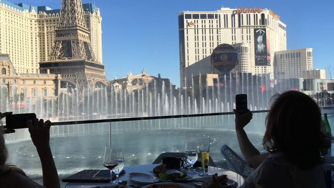 Sisters from Pittsburgh take in the Bellagio fountains show from a prime table at Lago by Julian Serrano.
