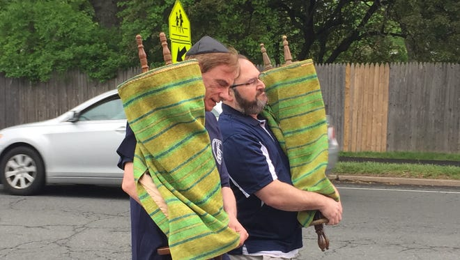 Steve Dachs, left, and Steve Forman members of Reform Temple of Rockland, and former members of Temple Beth El, begin the march of the Torahs on Viola Road on Sunday. Participants divided the 12-mile march in half-mile sections, from Spring Valley to Upper Nyack.