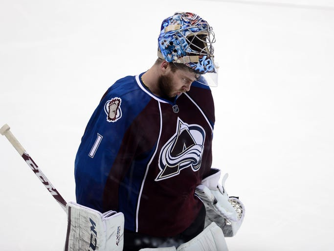 Apr 30, 2014; Denver, CO, USA;  Colorado Avalanche goalie Semyon Varlamov (1) leaves the ice following the loss to the Minnesota Wild in a overtime period in game seven of the first round of the 2014 Stanley Cup Playoffs at Pepsi Center. Mandatory Credit: Ron Chenoy-USA TODAY Sports