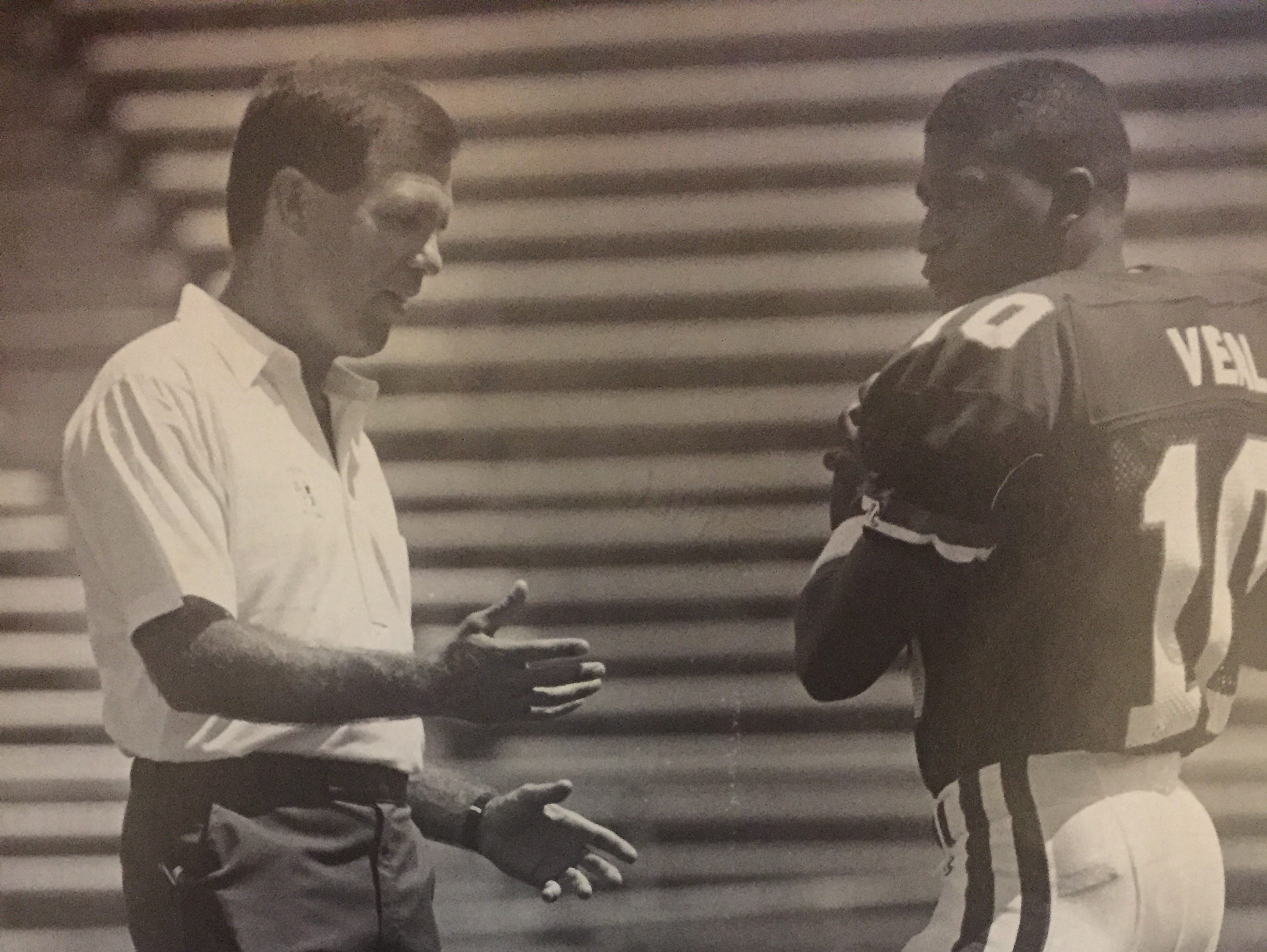 University of Arizona coach Rip Sherer, who starred at Toms River High School in the late 1960s, works with a Wildcats quarterback in 1989.