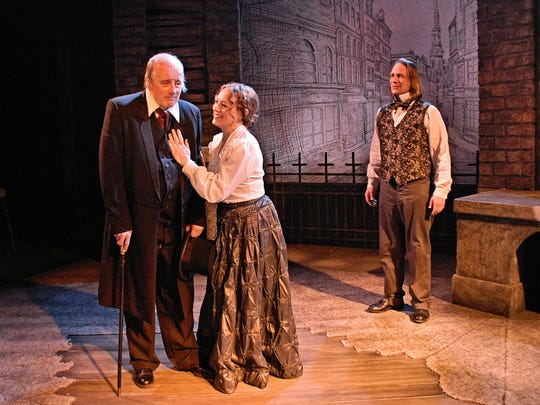 "Richard Maynard, left, stars as Ebenezer Scrooge in Repertory Theater of Iowa's staging of ""A Christmas Carol"" at the Des Moines Social Club."