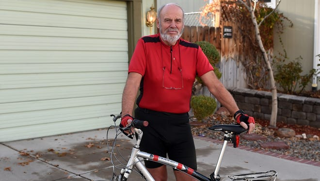 Hans Frischeisen, 73, stands with his bike in front of his home Reno. He has bicycled around the globe in several directions. He travels light with little more than a sleeping bag, a tent and some food. Frischeisen, who says his family barely escaped the Red Army invasion into Europe in the 1940s, spends much of his journeys advocating for peace. He also says he's nearing the end of his global cycling days, but he still wants to kayak through the United States from Canada to the Gulf of Mexico.