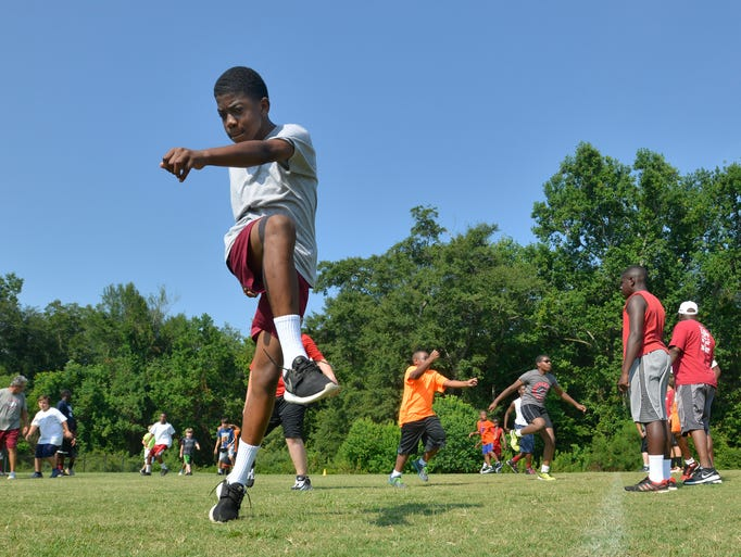 "Participants practice as DeMarcus ""Dee"" Milliner holds a football camp at his alma mater, Stanhope Elmore High School, in Millbrook, Ala., on Tuesday, July 8, 2014."