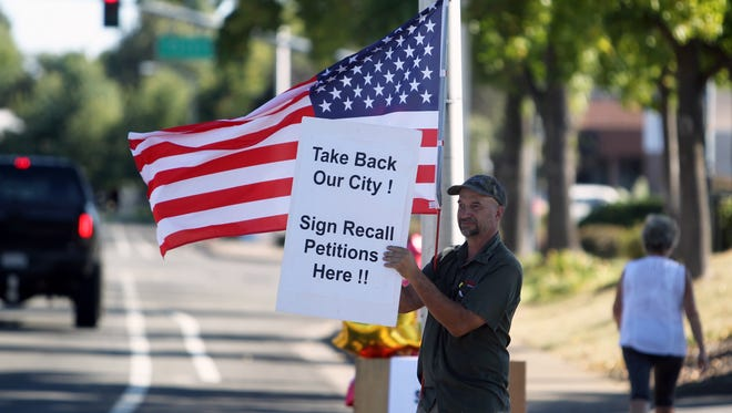 Dale Ball, one of the leaders of the campaign to recall two Redding City Council members, stands on Hartnell Avenue just south of Cypress Avenue during a signature-gathering event earlier this year.
