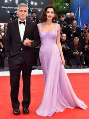 George and Amal Clooney walk the red carpet ahead of