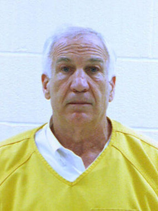 Jerry Sandusky's booking photo released early Saturday morning June 23, 2012, by the Centre County Correctional Facility in Bellefonte.