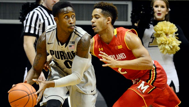 Purdue Boilermakers guard Jon Octeus (0) looks for his teammates while being defended by Maryland Terrapins guard Melo Trimble (2) during the first half of the game at Mackey Arena.