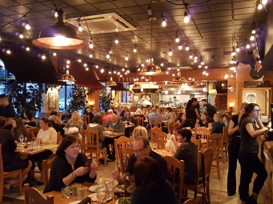 The dining room at the original Spago restaurant on Erie Street in Windsor's Little Italy was full on Thursday, Aug. 31.